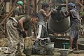U.S. Marine Corps Staff Sgt. John Suyat and Philippine volunteers mix cement.jpg