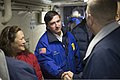 U.S. Navy Cmdr. Joel Stewart, right, the commanding officer of the amphibious transport dock ship Pre-Commissioning Unit (PCU) Anchorage (LPD 23), greets Dan Sullivan, center, the mayor of Anchorage, Alaska 130430-N-DR144-337.jpg