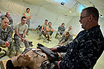 U.S. Navy Cmdr. Mike Coffel, a subject matter expert and guest lecturer with the Naval Expeditionary Medical Training Institute Role 3 Kanadahar Course, instructs other Sailors in a tourniquet class during 120807-N-GO179-008.jpg