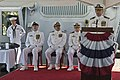U.S. Navy Cmdr. Scott A. Jones, at lectern, the commanding officer of the guided missile destroyer USS Donald Cook (DDG 75), delivers remarks after assuming command during a change of command ceremony aboard 130510-N-KE519-083.jpg