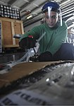 U.S. Navy Logistics Specialist Seaman Estevan Rivera, assigned to Strike Fighter Squadron (VFA) 146, packages an aircraft stabilator for shipment in the hangar bay of the aircraft carrier USS Nimitz (CVN 68) 130820-N-AZ866-193.jpg