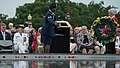U.S. Navy Rear Adm. Nora W. Tyson, second from left, the vice director of the Joint Staff, looks on as an Airman throws rose petals into a reflecting pond during a Memorial Day ceremony at the Women in Military 130527-D-KC128-014.jpg