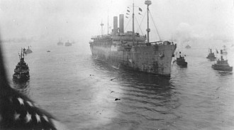 USS America (ID-3006) - America arrives Boston Harbor, 5 April 1919, with the 26th Army Division aboard.