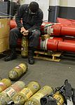 USS Bonhomme Richard Sailor refills a self-contained breathing apparatus 141204-N-ET721-005.jpg