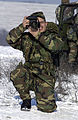 US Army (USA) Sergeant (SGT) Jose M. Hernandez assigned to the 55th Signal Company (Combat Camera), Fort Meade, Maryland, takes photographs on the Heritage Drop Zone near Klina, Kosovo, in support of Operation 030115-A-DO536-054.jpg