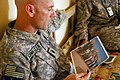 US Army 52968 TAJI, Iraq- Ozark, Ala. native, Lt. Col. Eric Schwegler, commander of the 1st Battalion, 82nd Field Artillery Regiment, 1st Brigade Combat Team, 1st Cavalry Division, views a picture of Sheik Abdullah.jpg