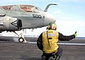 US Navy 030215-N-4154B-502 An Aviation Boatswain's Mate signals an EA-6B Prowler assigned to the.jpg