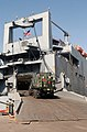 US Navy 030709-N-5362A-001 A U.S Marine heavy vehicle from the 1st Marine Expeditionary Force (1st MEF) drives into the cargo bay of the Military Sealift Command ship USNS Charlton (T-AKR 314).jpg