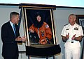 US Navy 030711-N-2439G-001 Capt. Jon Clark, USN Ret., and Rear Adm. Donald Arthur, Commander National Naval Medical Center (NNMC), applaud a portrait of Capt. Laural Clark taken by Bill McIntosh.jpg