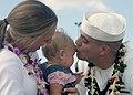 US Navy 031031-N-5539C-001 Electronics Technician 3rd Class Heath Spencer kisses his daughter after a long-awaited homecoming of USS Pasadena (SSN 752).jpg