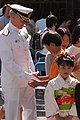 US Navy 040514-N-1194D-015 Commander Seventh Fleet, Vice Adm. Robert F. Willard, shakes hands with a Japanese boy at Gyokusenji Temple.jpg