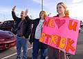 US Navy 041206-N-0685S-017 Family and Friends wave goodbye as they watch their love one depart aboard the amphibious assault ship USS Bon Homme Richard (LHD 6).jpg