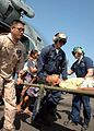 US Navy 050104-N-9293K-169 U.S. Navy personnel carry an injured Tsunami victim from an SH-60 Seahawk helicopter to the medical headquarters at Sultan Iskandar Muda Air Force Base in Banda Aceh, Sumatra, Indonesia.jpg