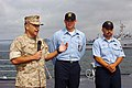 US Navy 050404-N-0685S-002 Commander, Expeditionary Strike Group Three (ESG-3), Brig. Gen. Joseph V. Medina, commends Seaman Brit L. J. Garrett, center, and Boatswain's Mate 2nd Class Alfonso Verni for their bravery durin.jpg