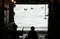 US Navy 050615-N-9866B-017 Deck Department Sailors direct amphibious assault vehicles, assigned to the 3rd Amphibious Assault Battalion, into the well deck aboard the amphibious assault ship USS Peleliu (LHA 5).jpg