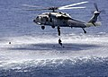US Navy 050625-N-6616W-003 A MH-60S Seahawk helicopter assigned to Helicopter Sea Combat Squadron Two Six Detachment Three (HSC-26), performs cast and recovery training.jpg