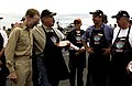 US Navy 050818-N-8213G-323 Commanding Officer, USS Ronald Reagan (CVN 76), Capt. James A. Symons, presents a gift to Tom Anton in appreciation of the ship's crew.jpg