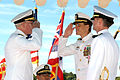 US Navy 051104-N-6507M-021 U.S. Navy Cmdr. Michael Pietkewicz, center, salutes Commander Submarine Force, Rear Adm. Jeffrey Cassias, left, as Cmdr. Mark Waller looks on at the Naval Submarine Support Command's change of command.jpg