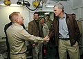 US Navy 060507-N-6403R-009 Cmdr. Richard J. Paver the senior medical officer aboard the amphibious assault ship USS Iwo Jima (LHD 7) greets Florida Congressman Ander Crenshaw, in the ship's medical triage.jpg