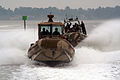 US Navy 060811-C-0000B-001 Riverine Squadron One members, based at Naval Amphibious Base Little Creek, train with Small Unit River Craft (SURC) Prototypes at the Special Missions Training Center.jpg