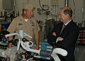 US Navy 060831-N-1755G-005 Chief Warrant Officer Robeert Steiner explains a machine operation to Secretary of the Navy, the Honorable Dr. Donald C. Winter during his visit to Naval Station Everett's Intermediate Maintenance Fa.jpg
