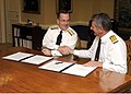 US Navy 061024-N-0696M-001 Chief of Naval Operations (CNO) Adm. Mike Mullen and First Sea Lord of the British Royal Navy, Adm. Sir Jonathon Band sign a letter of understanding for cooperative deployments during an office call a.jpg