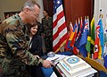 US Navy 070330-N-7653W-150 Commanding Officer, Capt. Kenneth J. Schwingshakl cuts a piece of cake at the establishing ceremony for Maritime Civil Affairs Group (MCAG).jpg