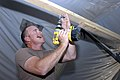 US Navy 070426-N-4928M-055 Builder 2nd Class Gregory Winters, a Navy Reservist from Tyler, Texas, prepares to hang fixed lighting.jpg