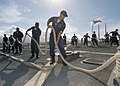 US Navy 070629-N-9698C-006 Sailors assigned to guided-missile destroyer USS Hopper (DDG 70) take in the lines before heading out for a Family and Friends Day Cruise.jpg