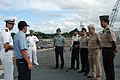US Navy 070814-N-7029R-015 Operations Specialist Seaman Hector Gonzales translates while Lt. Cmdr. Daniel Caldwell, USS Pearl Harbor (LSD 52) executive officer explains the ship's mission during a tour.jpg