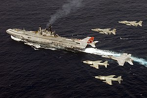 INS Viraat - Indian Navy Sea Harriers and Indian Air Force SEPECAT Jaguars with a US Navy F/A-18E Super Hornet flying over INS Viraat