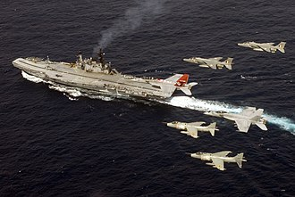 INS Viraat - Indian Navy Sea Harriers and Indian Air Force SEPECAT Jaguars with US Navy F/A-18 Super Hornets flying over INS Viraat