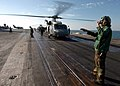 US Navy 071105-N-8132M-131 Aviation Electronics Technician 3rd Class Melissa Baker, a landing signal enlisted, prepares to launch an HH-60H Seahawk.jpg