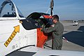 US Navy 071130-N-1923S-002 Chief Warrant Officer 2 Michael S. Adams, a flight student at NAS Whiting Field, practices a preflight inspection of the T-34C Turbo Mentor.jpg