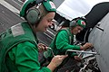 US Navy 071201-N-7526R-143 Aviation Electronics Technician 3rd Class Kathleen Hines, left, and Aviation Electronics Technician 1st Class Eric Klemstein, both from Strike Fighter Squadron (VFA) 25, perform routine maintenance.jpg