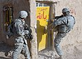 US Navy 071223-N-1132M-050 Soldiers attached to 2nd Squadron, 1st Cavalry Regiment breach a door during a clearing mission.jpg