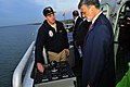 US Navy 081113-N-5758H-233 Cmdr. Don Gabrielson, commanding officer of the littoral combat ship USS Freedom (LCS 1) explains various functions of the ship's navigation system to Cleveland Mayor Frank G. Jackson during a tour of.jpg