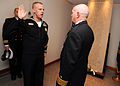 US Navy 090106-N-7948R-005 Rear Adm. Joseph F. Kilkenny reenlists Navy Career Counselor 1st Class Josh Vinson.jpg