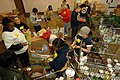 US Navy 090219-N-7544A-076 Sailors sort through food items checking expiration dates while volunteering at The Food Bank of Southeastern Virginia.jpg
