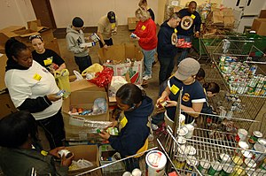English: NORFOLK (Feb. 19, 2009) Sailors sort ...
