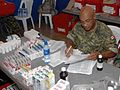 US Navy 090628-N-6259S-002 anadian Navy Leading Seaman Robert Morgan tracks medication in the pharmacy at a medical clinic in Loma Larga, El Salvador during a Continuing Promise 2009 medical community service project.jpg