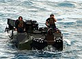 US Navy 090708-N-5538K-109 Marines assigned to the 31st Marine Expeditionary Unit (31st MEU) direct an amphibious assault vehicle to the well deck of the forward-deployed amphibious transport dock ship USS Denver (LPD 9).jpg