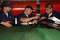 US Navy 090904-N-8119A-005 Machinist's Mate 1st Class Gery Poppleton, center, trains Machinist's Mate 2nd Class Dan Firestone and Machinist's Mate 3rd Class Anthony Roman.jpg