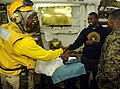 US Navy 100122-N-5345W-028 A Haitian man shakes the hand of Chief Warrant Officer Wilfrid Bossous before being transported with his mother to USNS Comfort (T-AH 20).jpg