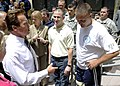 US Navy 100729-N-0208R-156 California Gov. Arnold Schwarzenegger speaks with Hospital Corpsman 3rd Class Anthony Ameen, center, and Marine Sgt. Maj. Patrick A. Wilkinson.jpg