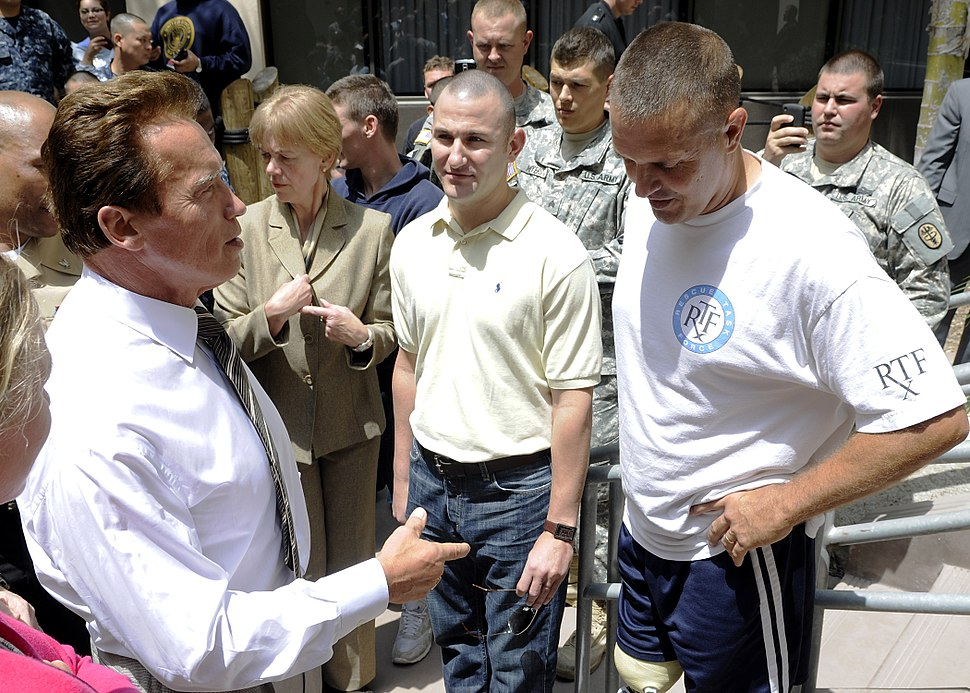 US Navy 100729-N-0208R-156 California Gov. Arnold Schwarzenegger speaks with Hospital Corpsman 3rd Class Anthony Ameen, center, and Marine Sgt. Maj. Patrick A. Wilkinson