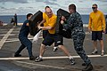 US Navy 100814-N-5319A-014 Operations Specialist 2nd Class Jack Boll defends against simulated attackers after being sprayed with oleoresin capsicum.jpg