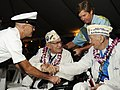 US Navy 101207-N-7498L-015 Art Herriford, left, president of the Pearl Harbor Survivors Association, greets fellow veteran DeWayne Chartier during.jpg