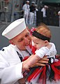 US Navy 110506-N-9985W-043 Engineman 2nd Class James Canipe hugs his baby daughter during the homecoming of USS Lake Champlain (CG 57) at Naval Bas.jpg