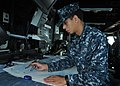 US Navy 110509-N-NL541-086 Quartermaster Seaman Ephrain Rivera, assigned to the guided-missile frigate USS Thach (FFG 43), performs nautical chart.jpg